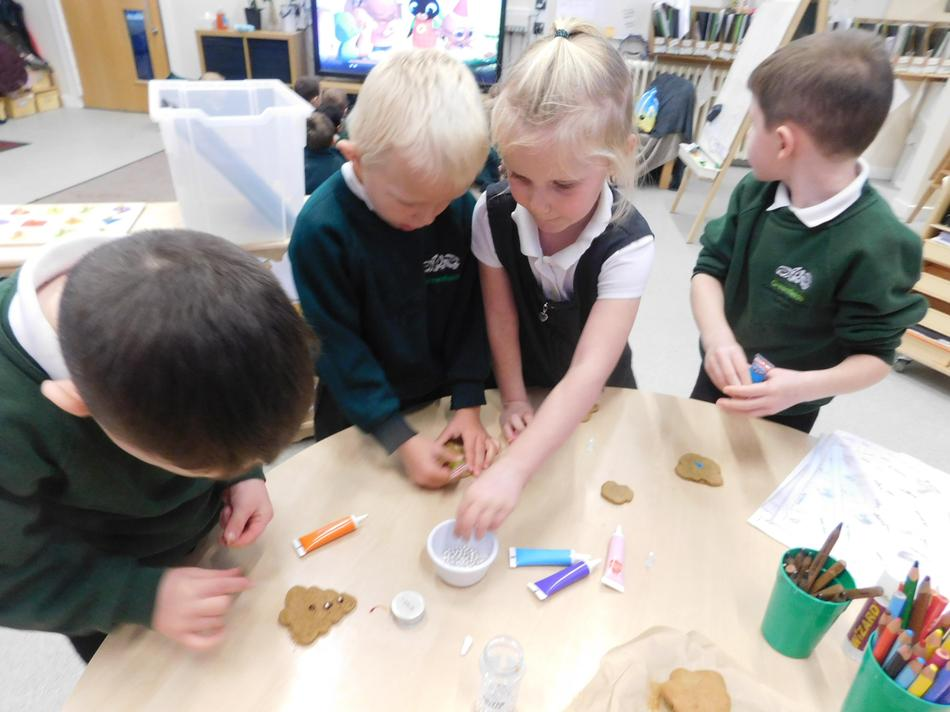 Decorating biscuits to sell.