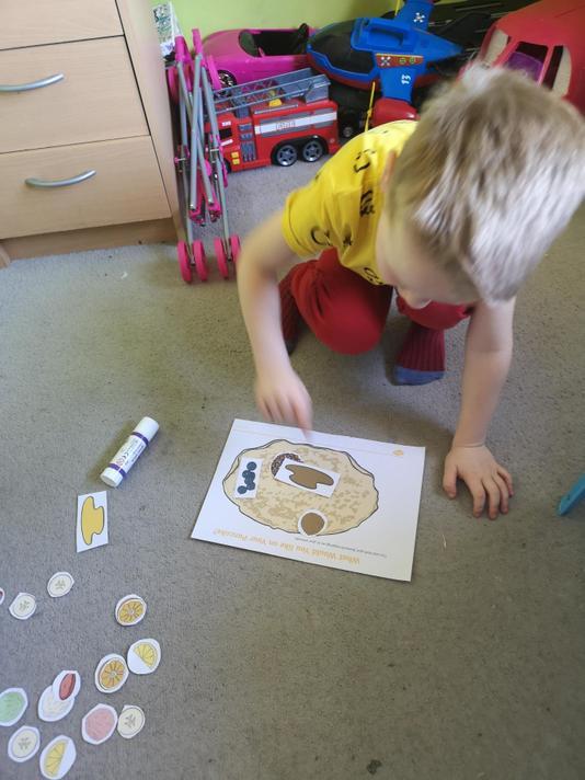 Alex placing toppings on his pancake.