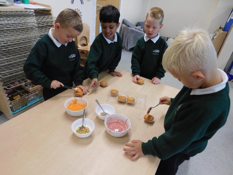 The children decorated cakes to sell tomorrow.