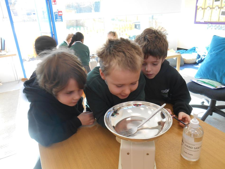 Olli, Aiden and Grayson measuring mass using standard units.