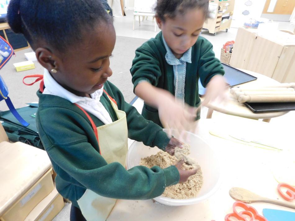 Imani and Sasha adding the butter.