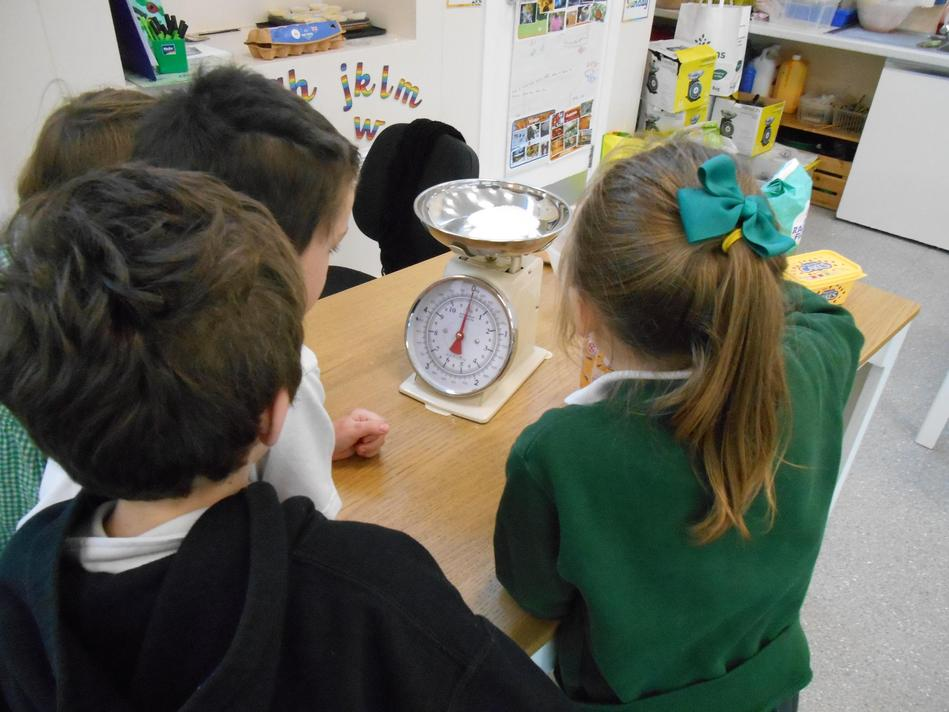 The children used their measuring skills to weigh ingredients for making fairy cakes.