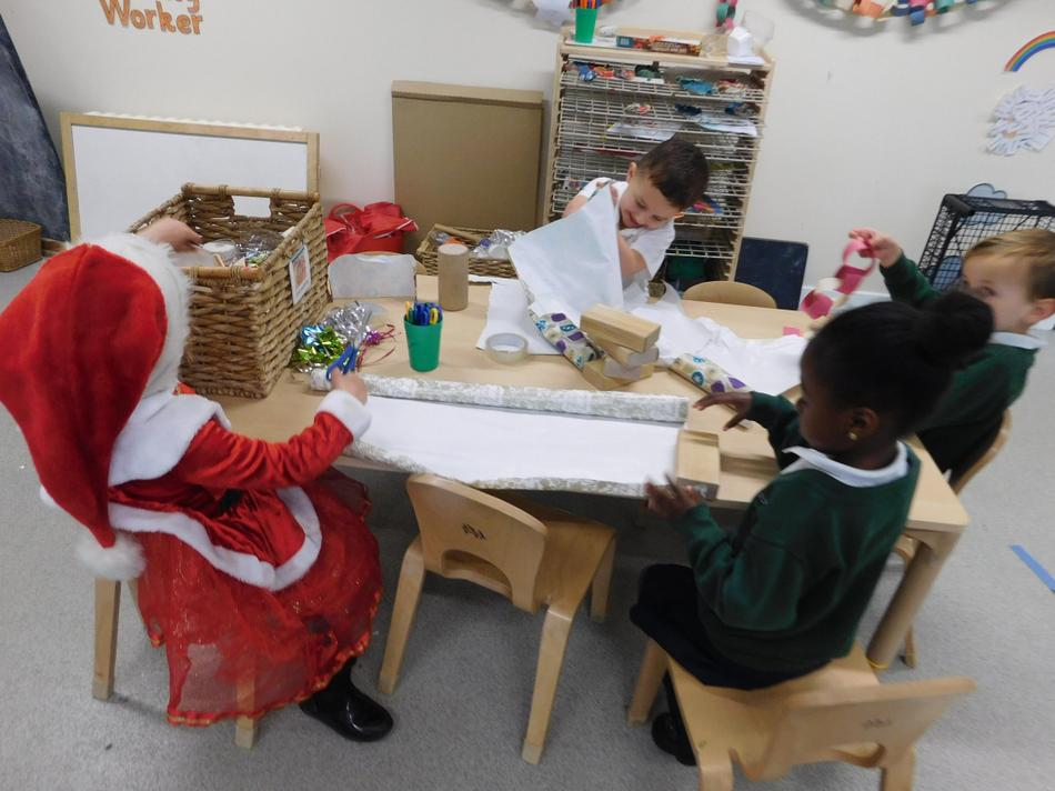 Zofia and Imani wrapping parcels.