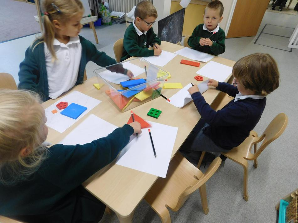 The children drew pictures using the 2D shapes.