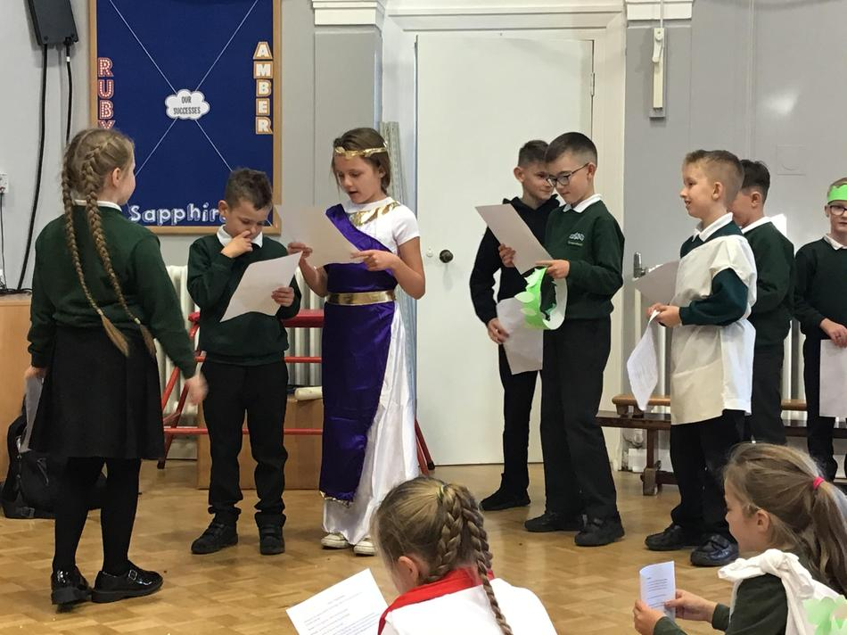 Acting out the play of Romulus and Remus.