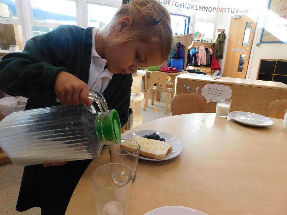 Zofia taking care to pour her own milk.