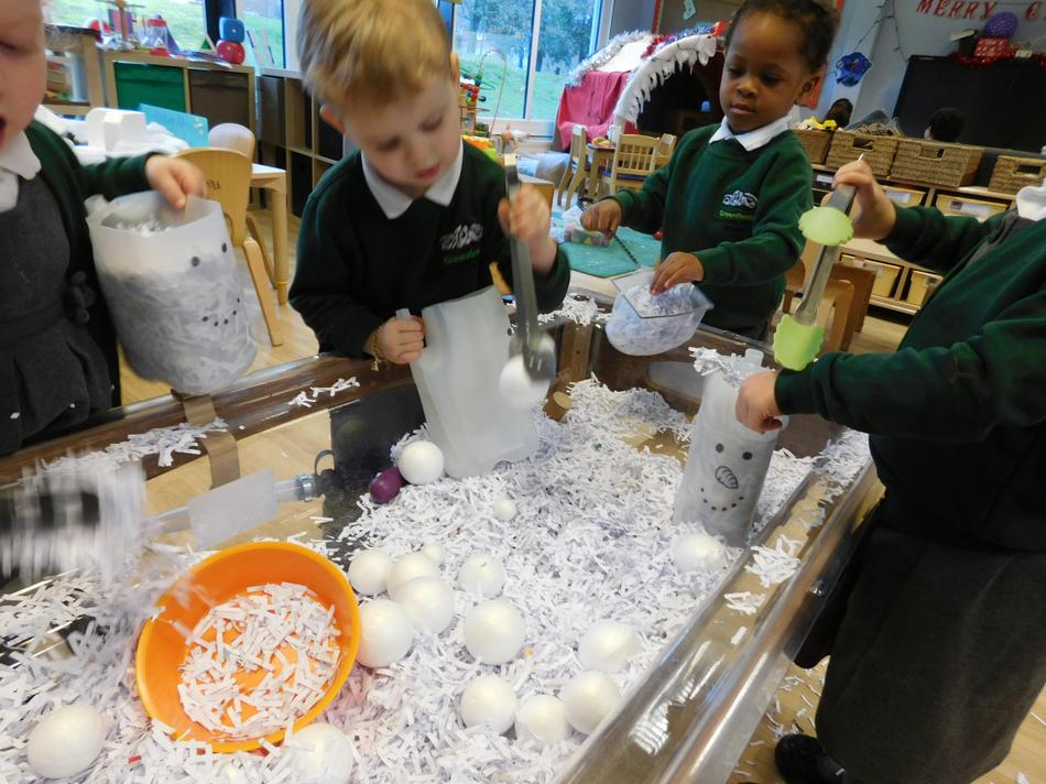 Maths work as well as fine motor, using tongs to pick up the 'snowballs'.