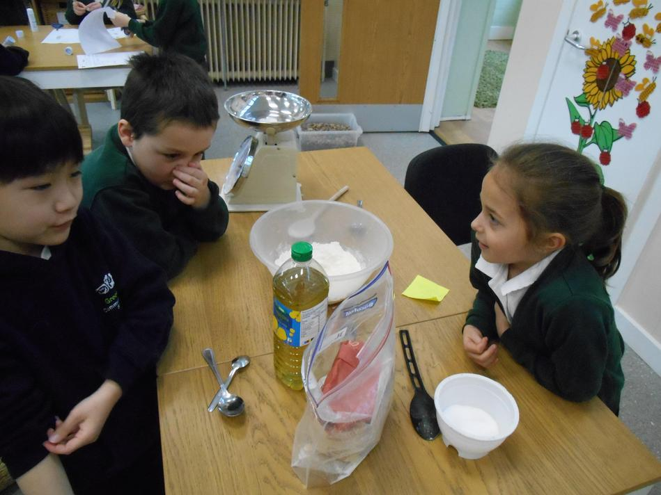The children used their measuring skills to weigh out ingredients for making playdough.