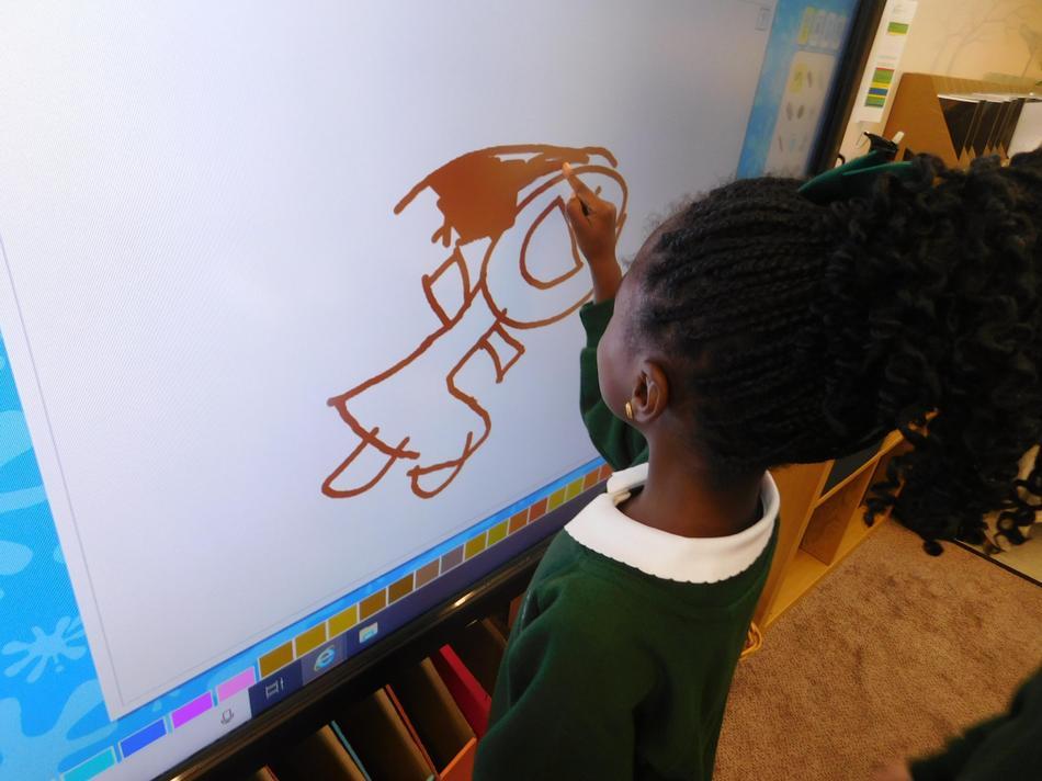 Imani creating a self-portrait
