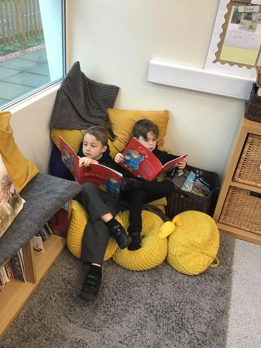 Getting cosy in the book corner!