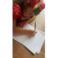 Elf Alicia writing her fairy tale