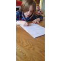 Benji writing his persuasive letter about climate change to Boris Johnson.