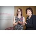 Mrs Horan receives the award