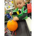Using a hammer and tees to make holes in a pumpkin