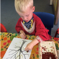 Using cotton buds to put leaves on our tree's.