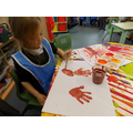 Using Autumn coloured paint for our Autumn trees.