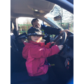 We got to pretend to drive the police car