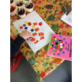 Sponge painting colours onto Elmer