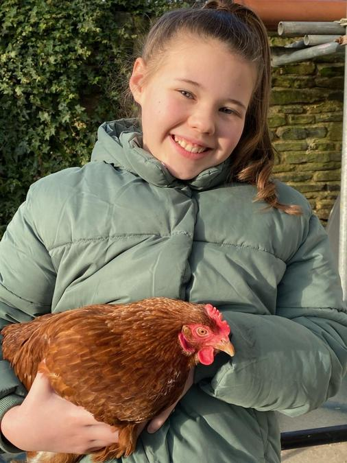 Lily and her pet chicken Beryl!