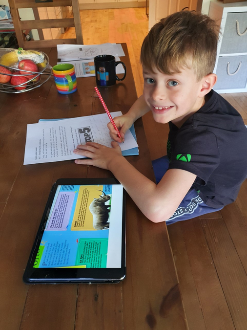 William enjoying the non-fiction text!
