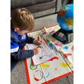 Harrison exploring the world around him.