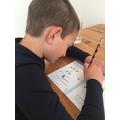 Zach working hard on his maths