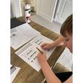 Harrison hard at work on White Rose Maths.