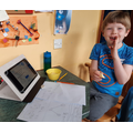 Oliver enjoying his maths.