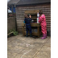 Lucy having fun in the mud kitchen.