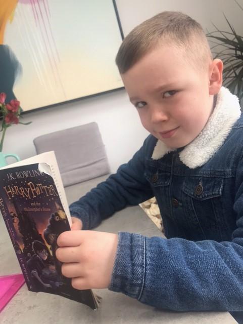 Lyle enjoying Harry Potter