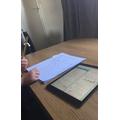 Scarlett working hard on her maths.