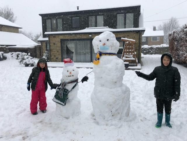 Laura and Lukas with their snow people