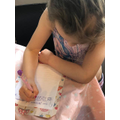 Writing a lovely letter to grandma and grandad.