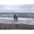 Ollie and his Dad braving the sea...bbrrrrr!