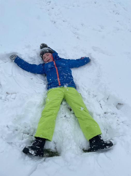 Josh making snow angels
