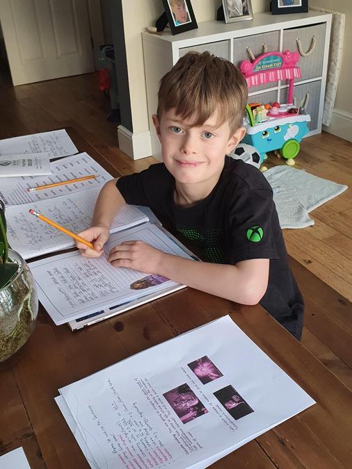 William working hard in English