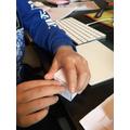 Folding & sticking the edges together carefully.