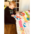 Noah making VE Day bunting.