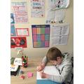 Oliver hard at work in his school corner.