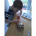 Lewis making an aboriginal bowl.