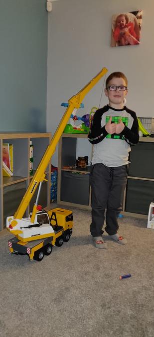 Joshua's vehicle is taller than him!