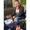 Lily's painting stones in the sunshine!
