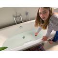 Elizabeth investigating floating and sinking!