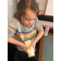 Lucy making butter.