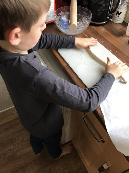 Tom rolling out salt dough for his Stone Age pot