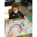 Max drew a Leeds United picture with a rainbow.