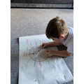 Harrison has been practising telling the time.