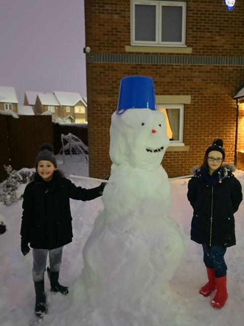 George and Sophie with their huge snowman!