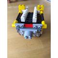 Lewis has designed a vending machine robot.