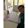 Avan working on Maths with a smile.